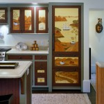Paintings by Hope Angier decorate cabinets in a small kitchen in the guest apartment over the garage.