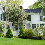 The rambling house dates to 1830 and 1870 with a 20th-century Colonial Revival addition.