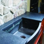 A solid block sink with a bow inset with a Bucks County Soapstone coin.