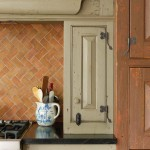 A custom finish and blacksmith-made hardware complete the period style of cabinets and woodwork; counters are soapstone.