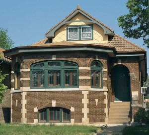Many of Chicago's famous bungalows were built with clay roofs, like this example sporting earth-colored flat French tiles.