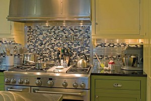 Mosaic glass tiles offer texture to the space.