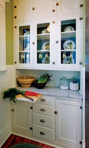 Ryan and Montana customized the salvaged butler's pantry by adding glass doors.