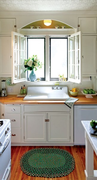 Salvaged casement windows, butcher-block countertops, and an antique sink returned light to this once-dark kitchen in a 1905 Colonial Revival.