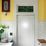 The swinging door to the dining room retains its original stained glass transom.