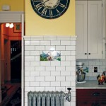The use of white tiles with a dark grout helps to give the kitchen a French feel.