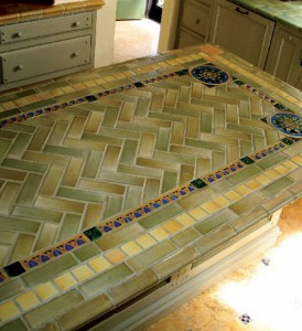 Cutting the angles of the herringbone tile freehand proved to be the biggest challenge to installing tile on the island.