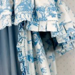 Bed curtains of Cowtan & Tout's blue 'Farnsworth' cotton toile edged with box pleats. Photo: William Wright