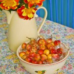 Fresh-picked cherries on a bed of ice and a pitcher of yard marigolds attest to summer's abundance.