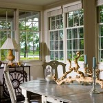 The dining table and chairs in the sunporch are Swedish Gustavian.