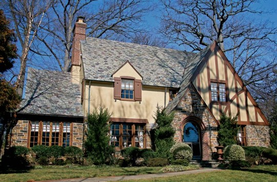 This Old English house uses half-timbering, stone, and stucco in a picturesque design of the 1920s.