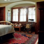 The one-time master bedroom has matching closets on either side of the alcove.