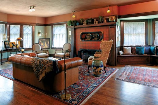 The home's parlors have been returned to their original appearance, with gleaming woodwork and appropriate light fixtures. The fireplace is faced with distinctive Seneca quarry tile.