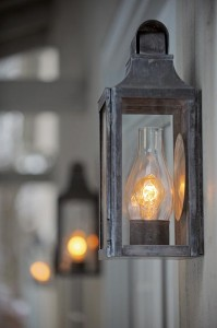 New England Barn lanterns shown in leaded copper add a period touch to the exterior lighting scheme.