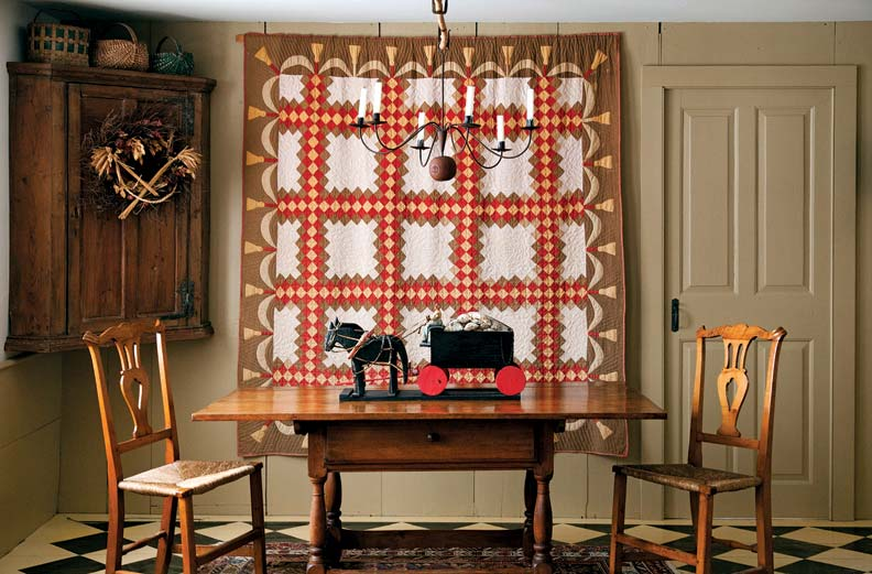 Americana abounds in the space, including this handsome quilt and folksy horse and cart.