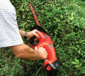 Electric tools like a cordless trimmer make easy work of overgrown shrubs and trees.