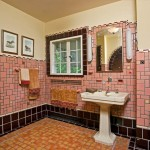 A bathroom makes a fashionable statement with an array of square and rectangular tiles in a variety of sizes, two separate pencil border treatments, and a variety of Arts & Crafts geometric decorative inserts.