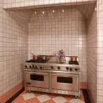 Field tiles in the kitchen come in two hues—a pale grayish mauve, and stripes of bright salmon.
