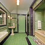 The master bathroom's tiled bath mat, wall decoration, and iridescent zigzag border bear a strong Art Deco influence.