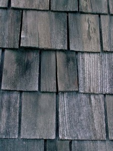 The broken shingle (center) has split in half, creating a potential pathway for water to enter the house.