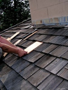 With the butt end in your hands, slide the shingle into position under the course above.
