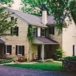 Removing the stucco from the house's stone exterior took mason Cleveland Ambris three months.