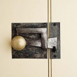 A restored antique door latch by Monroe Coldren & Son adds a note of authenticity to the stairwell door.