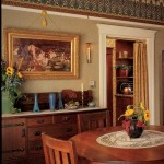 In the Victorian dining room, the picture rail is mounted below a papered frieze; note the button and tassel covering the hook. Photo: William Wright