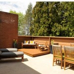 The upper-floor balcony is an outside living area, as Wright intended.