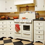 A 1950s O'Keefe & Merritt stove anchors the kitchen, which pairs tile in a Southwestern border motif with black Caesarstone countertops.