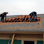Before cutting into the roof with a circular saw, contractors Chad Clark and Luke Higgins marked the dormer's placement.