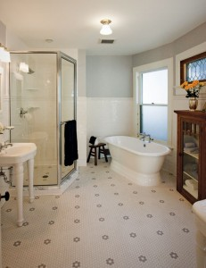 The floor's floral-patterned hex tiles continue unbroken through the shower, adding to the spacious feel.