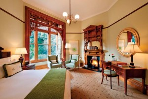The first-floor Botanical Suite, located in the former morning room, features woodwork similar to that in the drawing room.