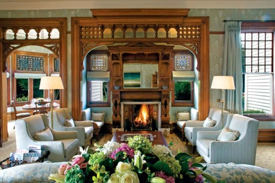 The Eastlake-style inglenook and stained glass in the drawing room are original to the house.