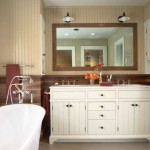 Vintage wall brackets illuminate the cottage-style double vanity cabinet.