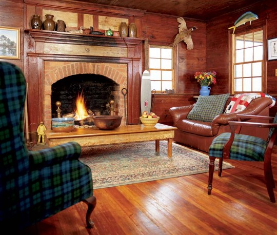 """There are two large rooms downstairs, flanked by two fireplaces of original brick and stone. Wood for the """"new"""" floors and siding came from a neighboring cabin and schoolhouse that were collapsing."""