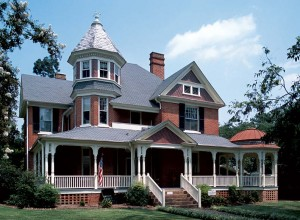 This substantial brick house in Edenton, North Carolina, has an unusually fine veranda with an octagonal extension on the right, balanced on the left by a three-story octagonal tower.