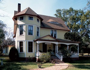 """Known as the """"Eyebrow Dormer House,"""" this handsome Queen Anne with a distinctive three-story bay window at the left is in the small central Florida town of Lake Helen."""