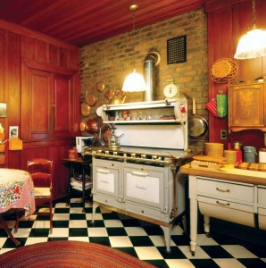 "The kitchen of the 1907 Evans House in California is dominated by a 1926 Smoothtop gas range, promoted for its compact cooking surface ""that makes possible smaller kitchens."" The two-tone color and oven heat regulators were other breakthroughs for the era."