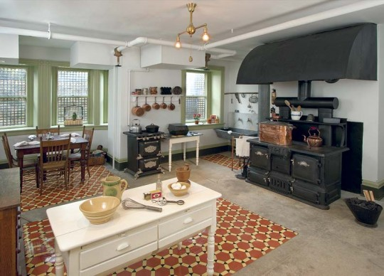 Two ranges are the main course of the 1910-1925 kitchen at Maymont in Richmond, Virginia. The hood over the coal-burner is evidence of how much heat these units produced; the early gas range (at left) needed neither the exhaust nor the floor space.