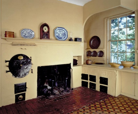 Stunningly advanced for 1807, the centerpiece of the Rundlet-May House kitchen in Portsmouth, New Hampshire, is a Rumford range—a brick firebox with iron top (now gone) and registers to control heat. Note the eponymous Rumford Roaster beside the hearth.