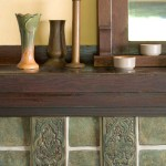 Decorative tiles form the corbel under the mantelshelf in a fireplace surround by Native Tile.