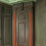 A corner cupboard, also in the parlor. Paint has oxidized; it would have been a lighter and brighter green.