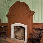 A close-up shows the decorative moldings of the great-room fireplace.