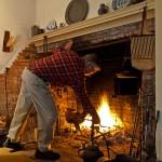 The owners split time between the 18th century and the present. They practice hearth cooking in the old part of the house.