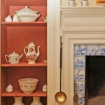 In the dining room, once the second-best parlor, original Delft tiles face a late 18th-century fireplace.