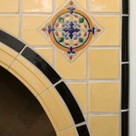 Southwest flavor in an arched fireplace surround for Santa Barbara's Biltmore Hotel, by Native Tile.