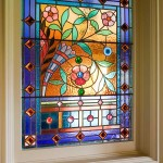 Art glass includes the dining room light featuring glass jewels.