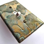 Wall Cakes switchplate cover in a ginkgo-leaf design.