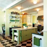 A green and white palette and open shelving further the kitchen's traditional look.